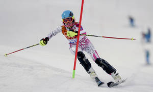 Photo - Lebanon's Jacky Chamoun skis in the first run of the women's slalom at the Sochi 2014 Winter Olympics, Friday, Feb. 21, 2014, in Krasnaya Polyana, Russia. (AP Photo/Charles Krupa)