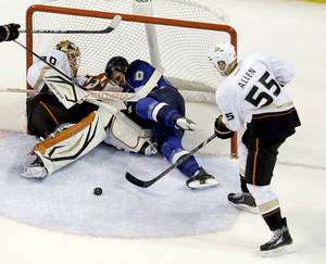 Photo - St. Louis Blues' Alexander Steen, center, collides with Anaheim Ducks goalie Viktor Fasth, left, of Sweden, as Ducks' Bryan Allen, right, clears the puck during the third period of an NHL hockey game, Saturday, Feb. 9, 2013, in St. Louis. The Ducks won 6-5 in a shootout. (AP Photo/Jeff Roberson)