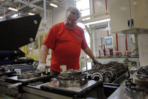 Photo - In this May 13, 2014 photo, Dave Roop, of Cicero, Ind., works on the line of a Chrysler transmission manufacturing facility in Tipton, Ind. The Institute for Supply Management releases its manufacturing index for May on Monday, June 2, 2014. (AP Photo/AJ Mast)