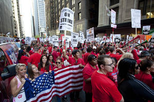 Photo - FILE - This Sept. 10, 2012, file photo shows thousands of public school teachers rallying outside the Chicago Public Schools district headquarters on the first day of strike action over teachers' contracts in Chicago. A majority of union members today now have ties to a government entity at the federal, state or local levels. The typical union worker now is more likely to be an educator, office worker or food or service industry employee rather than a construction worker, autoworker, electrician or mechanic, with far more women than men among the ranks. Overall, 11.3 percent of U.S. wage and salary workers are unionized, down from a peak of 35 percent during the mid-1950s.  (AP Photo/Sitthixay Ditthavong, File)