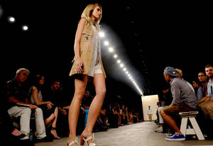 Photo -   The Billy Reid Spring 2013 collection is modeled during Fashion Week, Friday, Sept. 7, 2012, in New York. (AP Photo/Louis Lanzano)