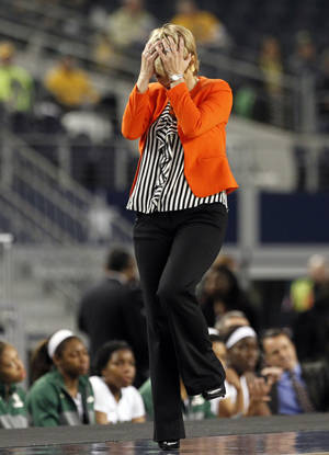 Photo - Baylor head coach Kim Mulkey turns away after her team was charged with a foul late in an NCAA college basketball game against Kentucky, Friday, Dec. 6, 2013, in Arlington, Texas. Kentucky won 133-130 in four overtimes. (AP Photo/Tony Gutierrez)