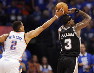 photo - Oklahoma City's Thabo Sefolosha (2) blocks the shot of San Antonio's Stephen Jackson (3) during Game 3 of the Western Conference Finals between the Oklahoma City Thunder and the San Antonio Spurs in the NBA playoffs at the Chesapeake Energy Arena in Oklahoma City, Thursday, May 31, 2012. Oklahoma City won, 102-82. Photo by Nate Billings, The Oklahoman