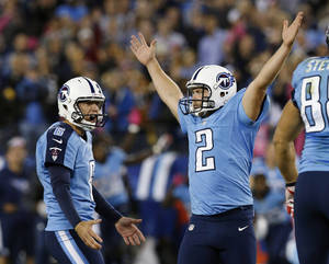 photo -   Tennessee Titans kicker Rob Bironas (2) reacts with holder Brett Kern (6) after kicking the game-winning field goal in the fourth quarter of an NFL football game against the Pittsburgh Steelers on Thursday, Oct. 11, 2012, in Nashville, Tenn. The Titans won 26-23. (AP Photo/Joe Howell)