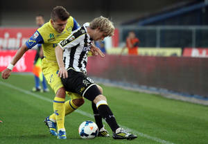 Photo - Udinese's Dusan Basta, right, of Serbia is challenged by Chievo forward Alberto Paloschi during a Serie A soccer match at Bentegodi stadium in Verona, Italy, Saturday, Sept. 21, 2013. (AP Photo/Felice Calabro')