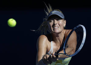 photo - Russia's Maria Sharapova hits a backhand return to compatriot Ekaterina Makarova during their quarterfinal match at the Australian Open tennis championship in Melbourne, Australia, Tuesday, Jan. 22, 2013. (AP Photo/Andy Wong)