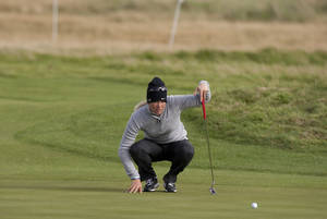 Photo -   Norway's Suzann Pettersen lines up a putt on the 17th green during the first round of the Women's British Open golf championships at Royal Liverpool Golf Club, Hoylake, England, Thursday Sept. 13, 2012. (AP Photo/Jon Super)