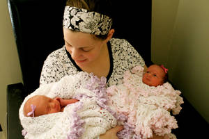 photo - Heather Kinney holds her newborn twin daughters, Lydia and Hannah. Heather Kinney, donated more than 2,000 ounces of breast milk while she was nursing her twin daughters. Photo provided. <strong></strong>