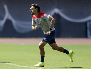 Photo - FILE - In this Monday, June 30, 2014, file photo, United States' Chris Wondolowski works out during a training session in Salvador, Brazil. Wondolowski, a member of the Kiowa Tribe, is playing in the World Cup. His presence on the U.S. soccer team is a source of pride for the tribe of 12,000 with headquarters in Oklahoma. (AP Photo/Julio Cortez, File)