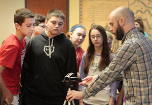 Photo - Moving image archivist Corey Ayers, right, teaches students from Washington Irving Middle School in Norman how to shoot video during a history program sponsored by The Smithsonian at the Oklahoma History Center.  Photo by David McDaniel, The Oklahoman <strong>David McDaniel - The Oklahoman</strong>