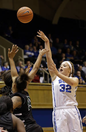 Photo - Duke's Tricia Liston (32) shoots against USC Upstate during the second half of an NCAA college basketball game in Durham, N.C., Thursday, Nov. 14, 2013. Duke won 123-40. (AP Photo/Gerry Broome)