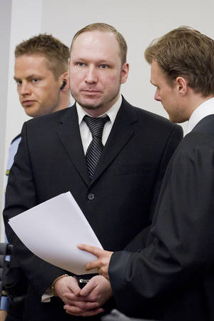 Photo -   Defendant Anders Behring Breivik seen talking to one of his lawyers, Tord Jordet, right, during the fourth day of proceedings in the courthouse in Oslo, Norway, Thursday April 19, 2012. Confessed mass killer Anders Behring Breivik testified Thursday that he had planned to capture and decapitate former Norwegian Prime Minister Gro Harlem Brundtland during his shooting massacre on Utoya island. (AP Photo / Erlend Aas)