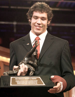 Photo - OU quarterback Sam Bradford is 1/16th Cherokee but is officially a citizen of the Cherokee Nation. AP PHOTO