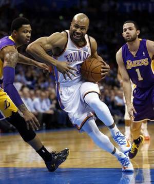 Photo - Oklahoma City Thunder's Derek Fisher (6) goes around Los Angeles Laker's Kent Bazemore (6) in the first half of an NBA basketball game where the Oklahoma City Thunder play the Los Angeles Lakers at the Chesapeake Energy Arena in Oklahoma City, on March 13, 2014. Photo by Steve Sisney The Oklahoman