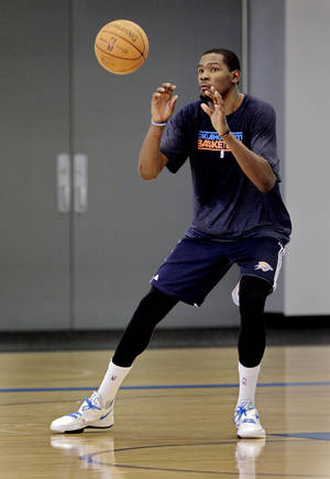Photo - Kevin Durant takes passes at the Oklahoma City Thunder practice facility on Friday, April 27, 2012, in Oklahoma City, Okla.  Photo by Steve Sisney, The Oklahoman