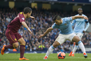 Photo - Manchester City's Sergio Aguero, right, keeps the ball from Watford's Cristian Battocchio during their English FA Cup fourth round soccer match at The City of Manchester Stadium, Manchester, England, Saturday, Jan. 25, 2014. (AP Photo/Jon Super)