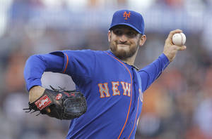 Photo - New York Mets' Jon Niese works against the San Francisco Giants in the first inning of a baseball game Friday, June 6, 2014, in San Francisco. (AP Photo/Ben Margot)