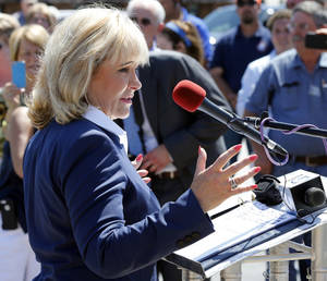 Photo - Oklahoma Governor Mary Fallin speaks during a ceremony as the Oklahoma Department of Transportation reopens the Highway 77 bridge between Lexington and Purcell on Friday, June 13, 2014 in Purcell, Okla.  Photo by Steve Sisney, The Oklahoman