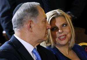 Photo - FILE - In this Israeli Dec. 1, 2013. file photo, Prime Minister Benjamin Netanyahu listens to his wife Sara during a meeting with the Roman Jewish Community at the Great Synagogue in Rome. A former employee at the official residence of Prime Minister Benjamin Netanyahu has filed a lawsuit alleging he was abused by the Israeli leader's wife, Sara. (AP Photo/Riccardo De Luca, File)