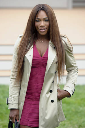 Photo - U.S tennis player, Serena Williams arrives for Burberry Prorsum show,  during London Men's spring summer fashion collections 2014, in London, Tuesday, June 18, 2013. (Photo by Jonathan Short/Invision/AP)