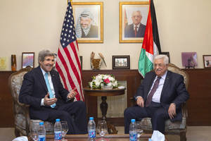 Photo - FILE - In this file photo taken Wednesday, March 26, 2014, U.S. Secretary of State John Kerry, left, meets with Palestinian President Mahmoud Abbas at the Palestinian Ambassador's Residence in Amman, Jordan, in an effort to salvage the Middle East peace talks as a breakdown looms.  (AP Photo/Jacquelyn Martin, Pool, File)