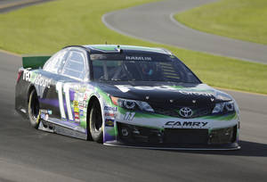 Photo - Denny Hamlin (11) qualifies for the pole position for Sunday's NASCAR Sprint Cup Series auto race at Pocono Raceway on Friday, June 6, 2014, in Long Pond, Pa. (AP Photo/Mike Groll)