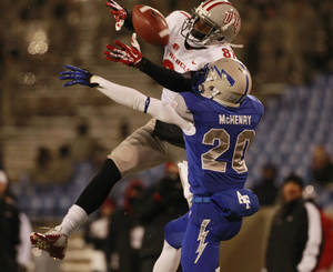 Photo - Air Force defensive back Gavin McHenry, front, is called for pass interference while covering UNLV wide receiver Maika Mataele in the fourth quarter of an NCAA football game at Air Force Academy, Colo., on Thursday, Nov. 21, 2013. (AP Photo/David Zalubowski)