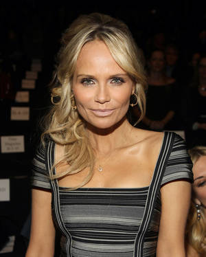 Photo -   FILE - In this Feb. 11, 2012 file photo, actress Kristin Chenoweth attends the Herve Leger Fall 2012 show during Fashion Week in New York. American Country Awards announced Tuesday, Aug. 28, 2012 that country star Trace Adkins and entertainer Kristin Chenoweth are returning as hosts of the 3rd American Country Awards. (AP Photo/ Donald Traill, File)