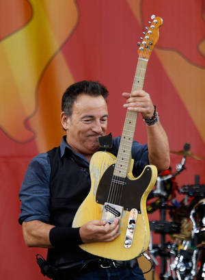 Photo -   Bruce Springsteen and the E Street Band play the Acura Stage at the 2012 New Orleans Jazz and Heritage Festival presented by Shell on Sunday, April 29, 2012. (AP Photo/The Times-Picayune, David Grunfeld) MAGS OUT; NO SALES; USA TODAY OUT