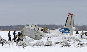 Photo -   Russian Emergency Ministry rescuers search the site of the ATR-72 plane crash outside Tyumen, a major regional center in Siberia, Russia, Monday, April 2, 2012. A passenger plane crashed in Siberia shortly after taking off on Monday morning, killing 32 of the 43 people on board, Russian emergency officials said. The 11 survivors were hospitalized in serious condition. The ATR-72, a French-Italian-made twin-engine turboprop, operated by UTair was flying from Tyumen to the oil town of Surgut with 39 passengers and four crew. (AP Photo/Marat Gubaydullin)
