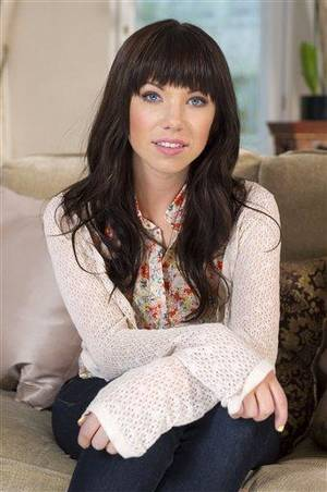 Photo - In this photo taken on Thursday, April 19, 2012 Canadian singer, Carly Rae Jepsen, poses for photographs following an APTN interview at the Landmark Hotel, London. (AP Photo/Jonathan Short)
