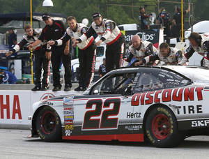 Photo - AJ Allmendinger celebrates with members of his team after winning the NASCAR Nationwide series Johnsonville Sausage 200 auto race at Road America, Saturday, June, 22, 2013, in Elkhart Lake, Wis. (AP Photo/Mike Roemer)