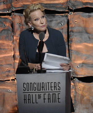 Photo -   Lifetime Achievement Award inductee Bette Midler accepts her award at the 2012 Songwriters Hall of Fame induction and awards gala at the Marriott Marquis Hotel, Thursday June 14, 2012 in New York. (Photo by Evan Agostini/Invision)