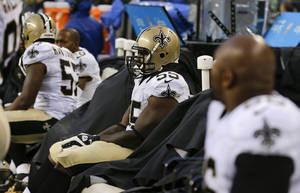 Photo - New Orleans Saints defensive end Keyunta Dawson sits on the bench during the fourth quarter of an NFC divisional playoff NFL football game against the Seattle Seahawks in Seattle, Saturday, Jan. 11, 2014. The Seahawks won 23-15. (AP Photo/Ted S. Warren)