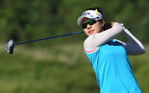 Photo - Last year's tournament winner Hee Young Park of South Korea hits a tee a shot on the way to shooting a 6-under par for a share of the at the Manulife Financial LPGA Classic Thursday, June 5, 2014 in Waterloo, Ontario. (AP Photo/The Canadian Press, Dave Chidley)