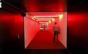Photo - Pedestrians walk through the red tunnel of the Underground, which connects to the County Office Building to two nearby parking garages. This area is where officials think water began to flood the tunnels during the May 31st storm. <strong>Steve Gooch</strong>