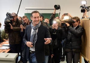Photo - Top candidate of the Freedom Party, FPOE, Heinz-Christian Strache, casts his vote in national elections at a polling station in Vienna, Austria, Sunday, Sept. 29, 2013. Austrians went to the polls to elect a new parliament. (AP Photo/Kerstin Joensson)