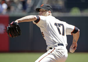 Photo - San Francisco Giants starting pitcher Tim Hudson throws against the Oakland Athletics in the first inning of their interleague baseball game Thursday, July 10, 2014, in San Francisco. (AP Photo/Eric Risberg)