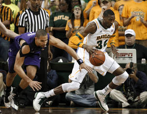 Photo - Baylor forward Cory Jefferson (34) grabs a loose ball and drives to the basket against Northwestern guard Drew Crawford during the first half of an NCAA college basketball game Tuesday, Dec. 4, 2012, in Waco, Texas. (AP Photo/Tony Gutierrez)