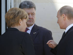 Photo - German Chancellor Angela Merkel, left, Russian President Vladimir Putin, right, and Ukrainian president-elect Petro Poroshenko, center, talk after a group photo before a luncheon as they take part in the 70th anniversary of D-Day in Benouville in Normandy, France, Friday, June 6, 2014. (AP Photo/Charles Dharapak)