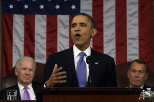 Photo - President Barack Obama, flanked by Vice President Joe Biden and House Speaker John Boehner of Ohio, gestures as he gives his State of the Union address during a joint session of Congress on Capitol Hill in Washington, Tuesday Feb. 12, 2013. (AP Photo/Charles Dharapak, Pool)