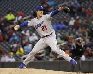 Photo - Los Angeles Dodgers starting pitcher Zack Greinke (21) delivers to the Minnesota Twins during the first inning of a baseball game in Minneapolis, Wednesday, April 30, 2014. (AP Photo/Ann Heisenfelt)