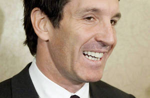 Photo - FILE - This is a Nov. 9, 2010 file photo showing Brendan Shanahan speaking to reporters in Toronto. Shanahan has been hired as the Toronto Maple Leafs NHL hockey team president and alternate governor, the team announced Friday. April 11, 2014. (AP Photo/The Canadian Press, Darren Calabrese, File)