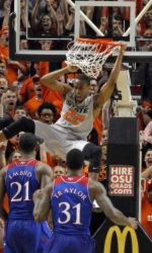 Photo - Mar 1, 2014; Stillwater, OK, USA; Oklahoma State Cowboys guard Markel Brown (22) reacts to dunking the ball against the Kansas Jayhawks during the second half  at Gallagher-Iba Arena. Oklahoma State beat Kansas 72-65. Mandatory Credit: Tim Heitman-USA TODAY Sports