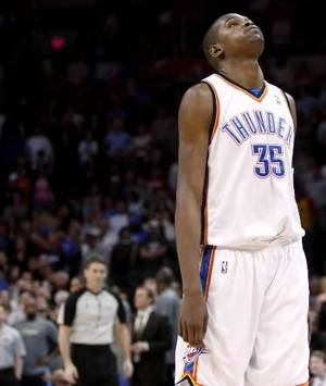 photo - Oklahoma City's Kevin Durant reacts after missing a shot in the final minute of the NBA basketball game between the Oklahoma City Thunder and the Denver  Nuggets at the Ford Center in Oklahoma City, Wednesday, April 7, 2010. Photo by Bryan Terry