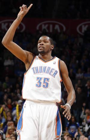 photo - Oklahoma City's' Kevin Durant (35) celebrates a three-point shot during the NBA game between the Oklahoma City Thunder and the Phoenix Suns at theChesapeake Energy Arena, Friday, Feb. 8, 2013.Photo by Sarah Phipps, The Oklahoman