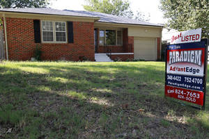 photo -   In this Friday, Sept. 21, 2012, photo,a home is for sale in Oklahoma City. Average U.S. rates on fixed mortgages fell again to new record lows. The decline suggests the Federal Reserve's stimulus efforts may be having an impact on mortgage rates. Mortgage buyer Freddie Mac said Thursday, Sept. 27, 2012, the rate on the 30-year loan dropped to 3.40 percent. That's down from last week's rate of 3.49 percent, which was the lowest since long-term mortgages began in the 1950s. (AP Photo/Sue Ogrocki)