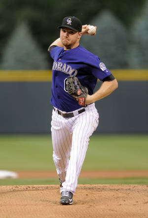 Photo -   Colorado Rockies starting pitcher Alex White throws against the San Diego Padres during the first inning of a baseball game on Friday, Aug. 31, 2012, in Denver. (AP Photo/Jack Dempsey)
