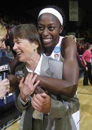 Photo - Stanford coach Tara VanDerveer is hugged by forward Chiney Ogwumike, rear, during an interview after a regional final against North Carolina in the NCAA women's college basketball tournament in Stanford, Calif., Tuesday, April 1, 2014. Stanford won 74-65. (AP Photo/Marcio Jose Sanchez)