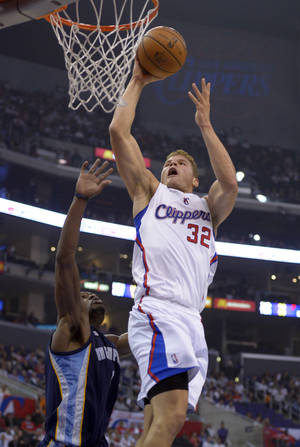 Photo -   Los Angeles Clippers forward Blake Griffin, right, goes up for a dunk as Memphis Grizzlies guard Tony Allen defends during the first half of their NBA basketball, Wednesday, Oct. 31, 2012, in Los Angeles. (AP Photo/Mark J. Terrill)